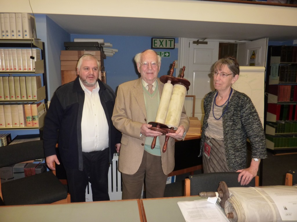 The Scroll being returned to Leslie Lipert by Bernard Benarroch , Sofer in the presence of Angel Broome, Museum Librarian  - December 2014